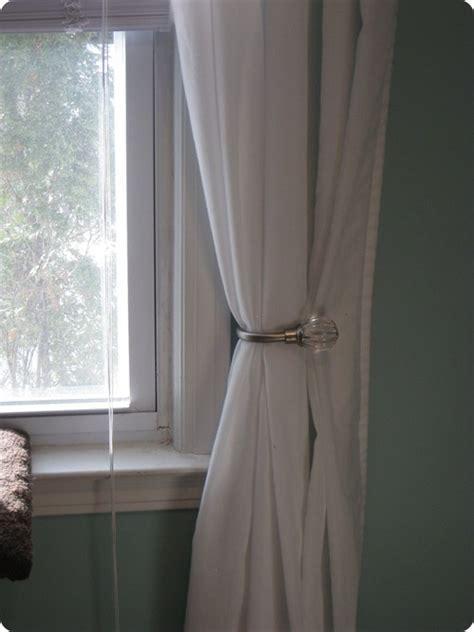 how to install window curtain holdbacks free