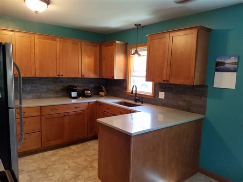maple kitchen cabinets with quartz countertops kitchen remodel with maple cabinets and hanstone quartz