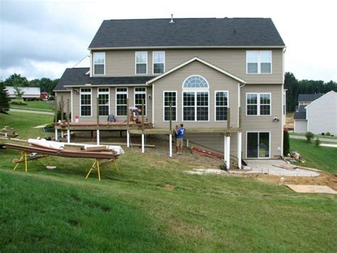 walkout basement design deck with walkout basement traditional other metro by rzonca construction the deck patio