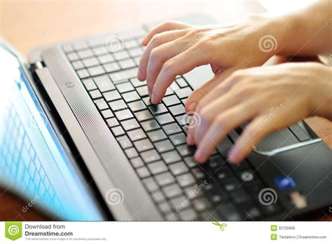 Female Hands Typing On A Laptop Pc Keyboard Stock Photo