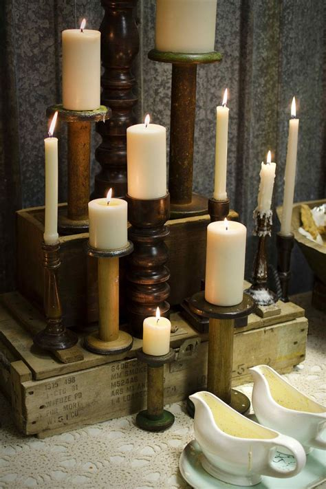 Food table centerpiece with DIY textile wooden spool candle stands. See more rustic wedding