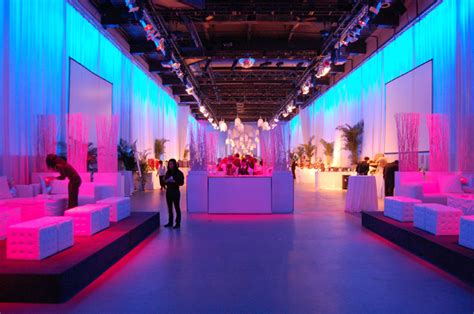 pink and blue lighting accented the all white decor in the