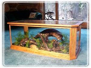oak and glass coffee table with montana otter scene With glass enclosed coffee table