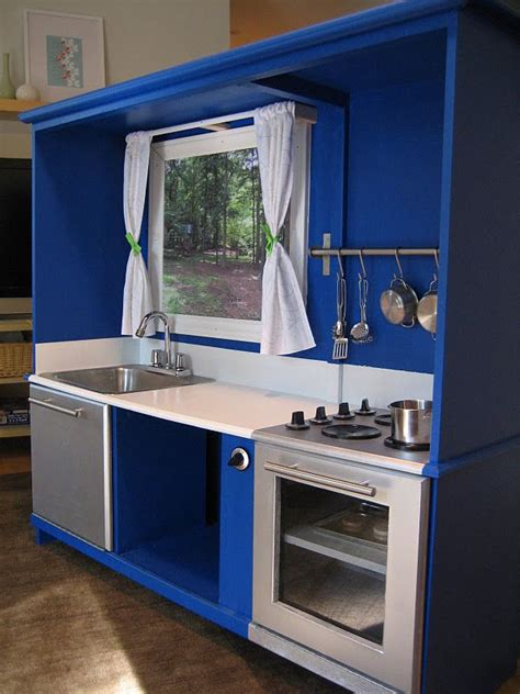play kitchen ideas an old entertainment unit converted to a kids kitchen awesome they show step by step pictures
