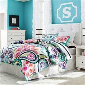 Bright colors with mixed patterns in this girl s room