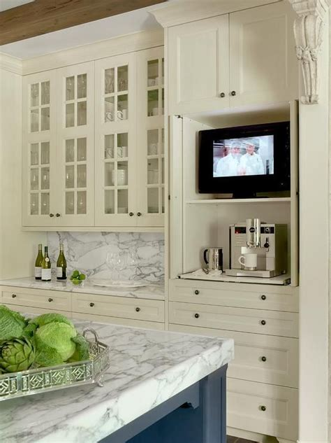 tv for kitchen cabinet glass front ivory kitchen cabinets are mounted above ivory 6413