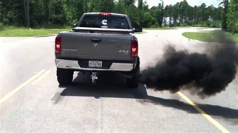 cummins charger rollin coal 5 9 cummins rollin coal and burnin tires youtube