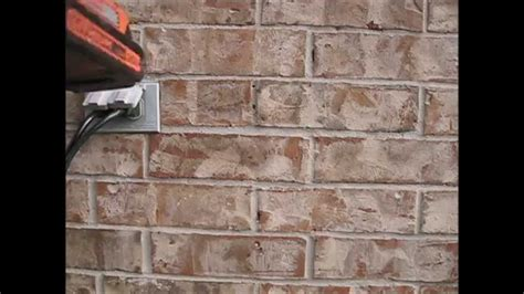 attaching a to a brick wall
