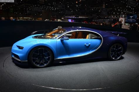 Four getting settled behind the wheel of the bugatti chiron. Bugatti Chiron with 1500 horsepower