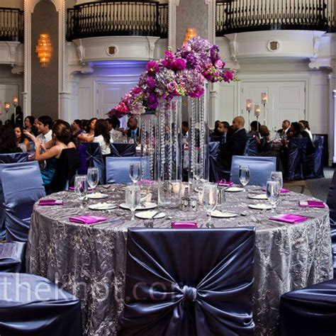 wedding decor purple and silver textured silver linens and gun metal chair covers complemented the room s existing decor and