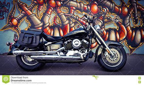 Grafiti Motor : Black Motorcycle And The Graffiti Wall Editorial