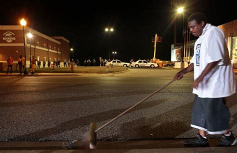 six arrests made as protests in ferguson stay small