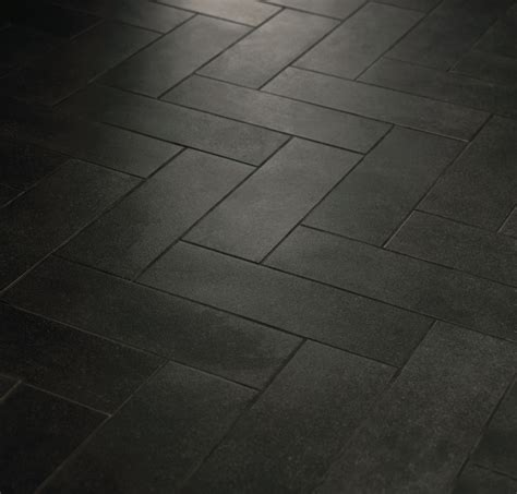 light tile with dark grout herringbone pattern with crossville tile main street