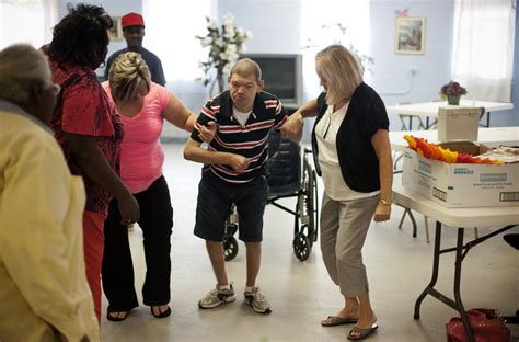 moving mentally disabled  institutions  group homes