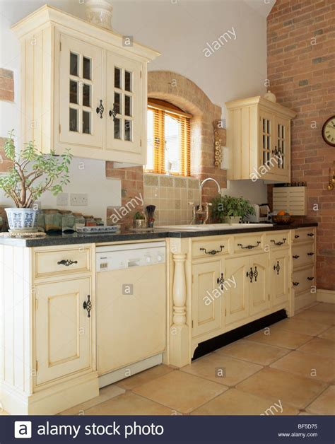 Traditional cream country kitchen with dishwasher in