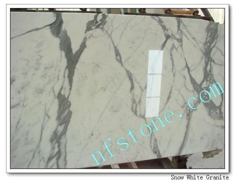 snow white granite slab kitchen