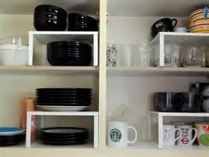 kitchen storage solutions cupboard organizer raised