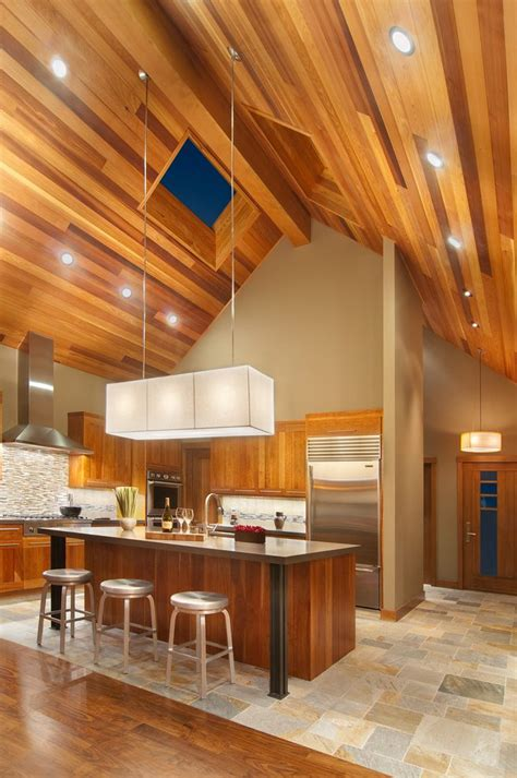 wood ceilings give  warm    kitchen