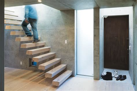 steel and wood staircase photo 5 of 7 in open plan concrete home in dwell
