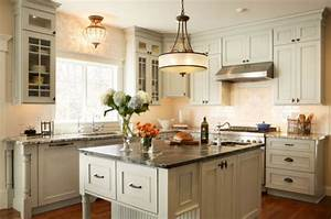 Large single pendant light above a small kitchen counter