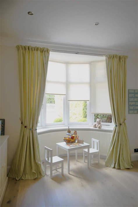 bay window with blinds and curtains window treatments