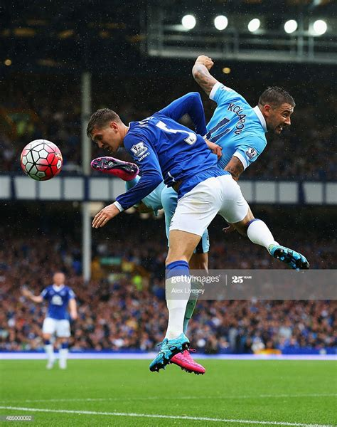 John Stones of Everton challenges for the ball with ...