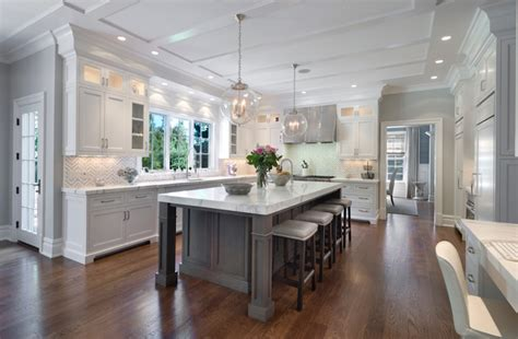 white kitchen with island white kitchen cabinets with gray kitchen island transitional kitchen blue water home builders
