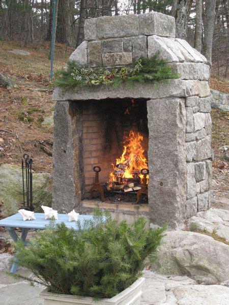 custom natural wood outdoor fireplace built   mix