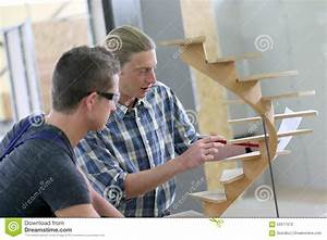 Young Apprentice With Instructor Working On Wood Stock