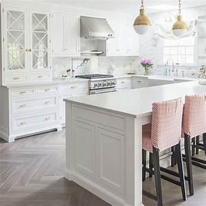 white kitchen with bleached hardwood flooring in herringbone pattern 1520