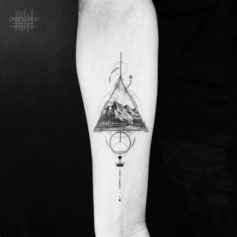 graphic mountain on the right inner forearm