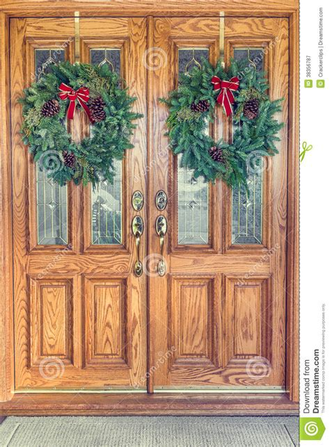 christmas wreaths  front doors royalty  stock