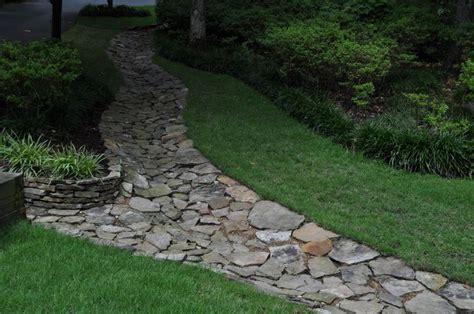 sloped driveway drainage attractive drainage swale backyard pinterest inspiration