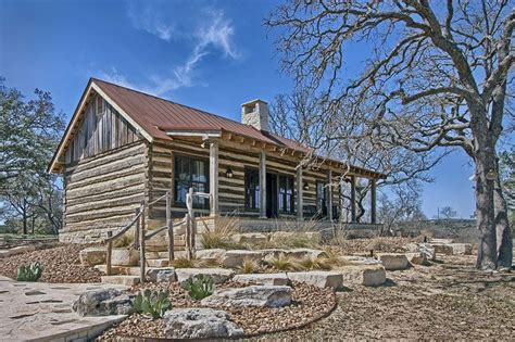 log cabin   texas hill country landscape architecture  paddle creek design builder