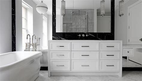white bathroom  black marble backsplash modern