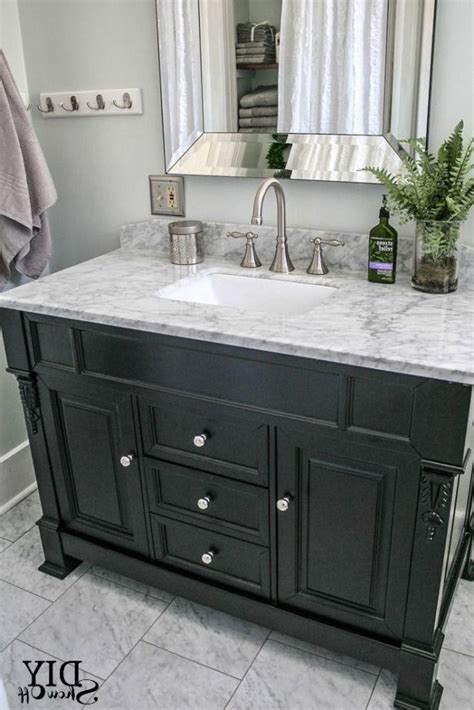 black bathroom vanity with white marble top cottage