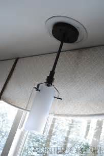 replacing can lights with pendant lights easily change a recessed light to a decorative hanging