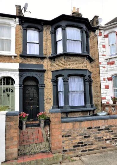 dark windows victorian house edwardian london paint