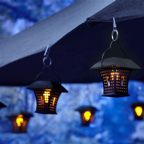 patio umbrella  hanging solar lights rustic patio