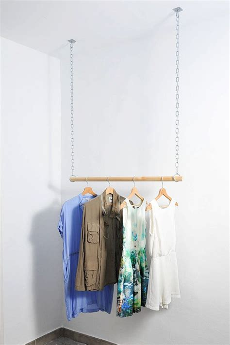 wooden floating hanging clothes rack van aveleredesign op