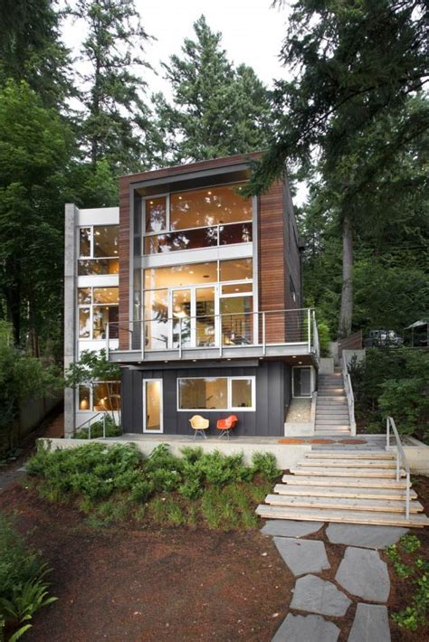 small footprint soaring stature modern vertical house maximizes views  nature