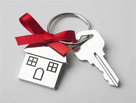 Walt Danley House Keys With Red Ribbon On Light Background