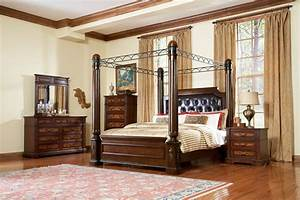 Cream Wooden Canopy Bed With Curving Head Board Also