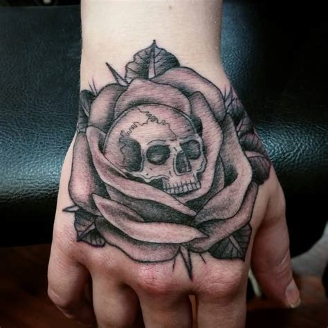 rose hand tattoos  women
