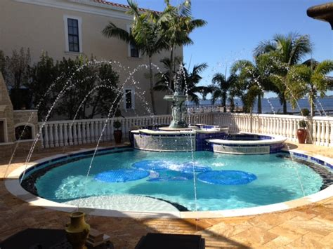 6 Swimming Pool Water Features Fountains, Deck Jets, And