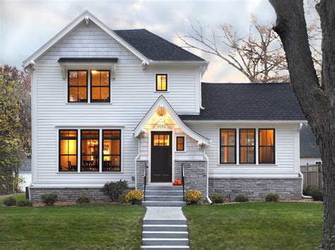 white stone exterior traditional with horizontal siding