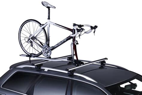 bicycle car racks thule outride roof mounted bicycle carrier