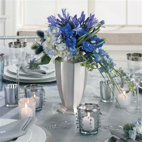 blue and silver flower arrangements blue and green floral centerpiece with silver accents by