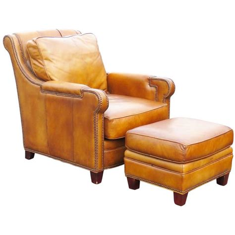 distressed brown leather lounge chair and ottoman at 1stdibs