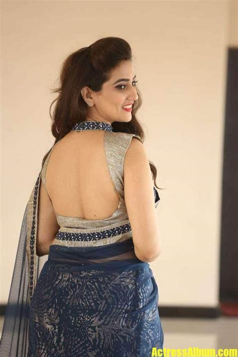 anchor manjusha  saree  backless blouse actress album